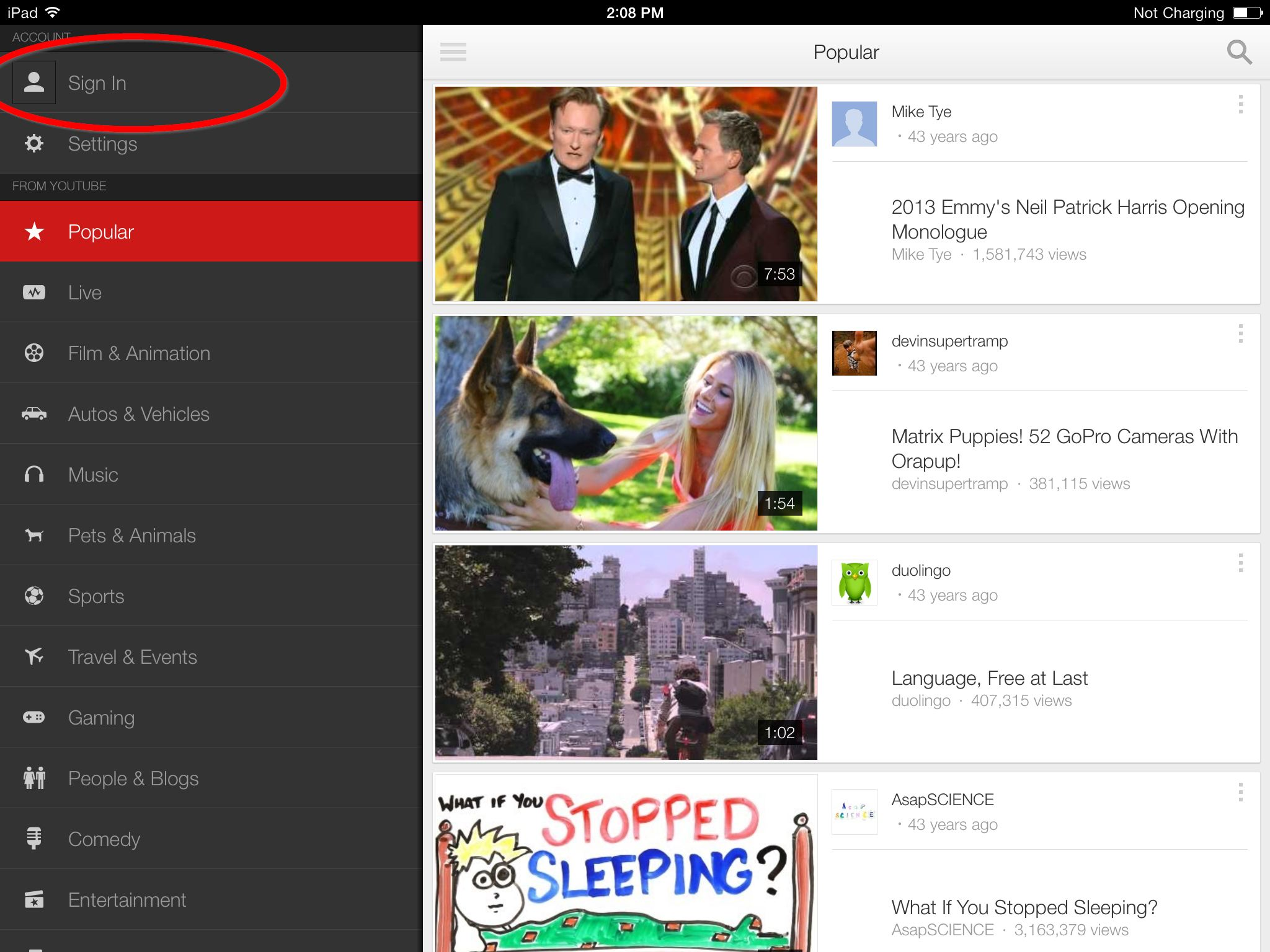 The YouTube interface, showing popular videos on the right and the menu bar on the left.
