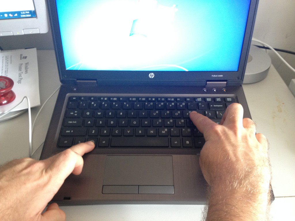 Picture shows user how to use the Windows P keyboard shortcut.